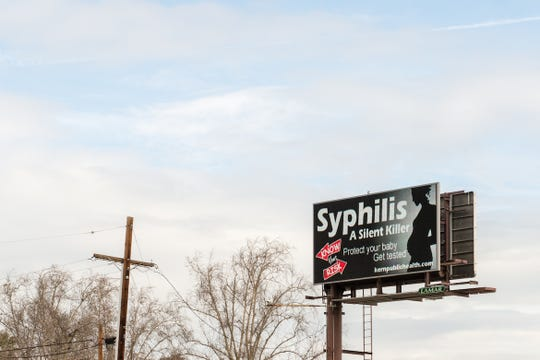 """An electronic billboard near downtown Bakersfield, Calif., displays a public service announcement about sexually transmitted diseases on February 2, 2017. The Kern County public health department has embarked on a massive information campaign with the slogan, """"Know Your Risk."""""""
