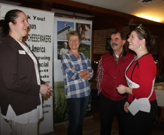 Dairy industry advocates, Esther and Tony Zgraggen, center, chat with Trisha Pernot, left, chairman of the 2019 Alice in Dairyland finals in Green County and Kaitlyn Riley, 2018 Alice in Dairyland.