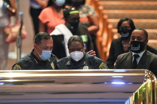 Houston Police Chief Art Acevedo and Assistant Chief Sheryl Victorian visit the open casket of George Floyd during a public visitation on June 8, 2020.