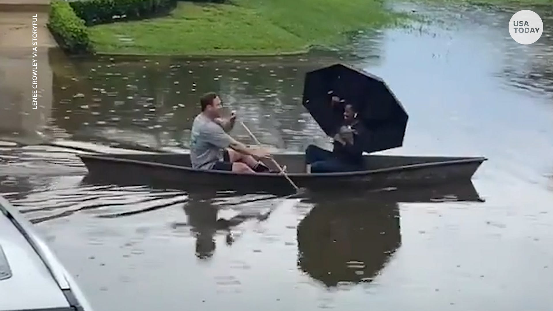 New Orleans man gives stranded neighbor much needed lift in canoe through flooded streets