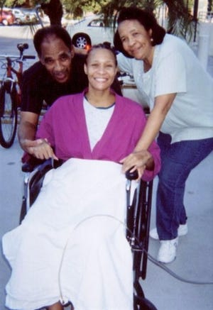 Alicia Cole is shown being wheeled out of the hospital in 2006 by parents Ron and Betty Cole.