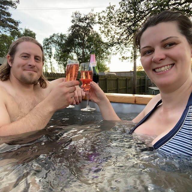 Elliot Roberts (left) and his spouse Sammi Miller (right) built a towable hot tub from scratch during the coronavirus lockdown.