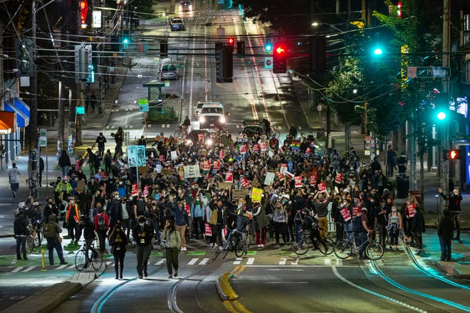 Demonstrators march in Seattle on Tuesday.