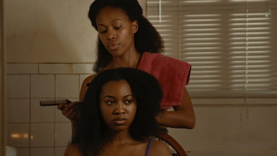 """A moment from the new film """"Miss Juneteenth"""" shows Nicole Beharie's character explaining to her daughter Kai (Alexis Chikaeze) the importance of the beauty pageant."""