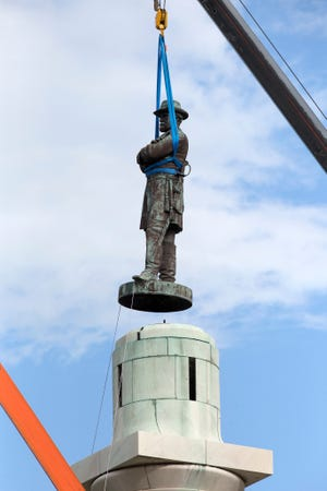 A statue of Confederate General Robert E. Lee is removed from Lee Circle Friday, May 19, 2017, in New Orleans. Lee's was the last of four monuments to Confederate-era figures to be removed under a 2015 City Council vote on a proposal by Mayor Mitch Landrieu.