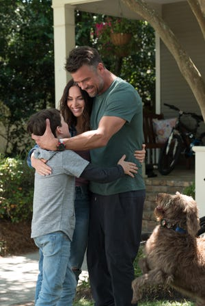 """Gabriel Bateman (left), Megan Fox and Josh Duhamel are the family at the center of """"Think Like a Dog."""""""