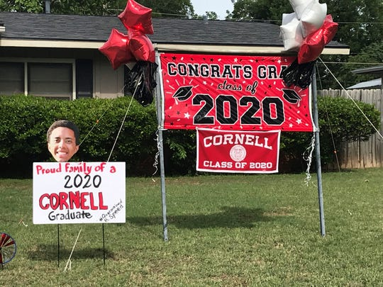 A yard display honors Baxter Speed, an Abilene High School graduate who recently graduated from Cornell.