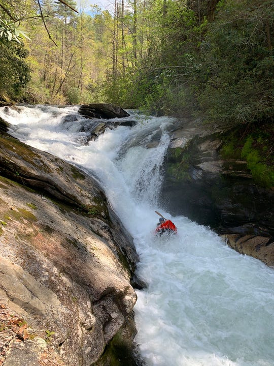 A kayaker paddles down Boxcar Falls on the North Fork of the French Broad River. The Nantahala and Pisgah National Forest Draft Plan finds nine streams newly eligible for Wild and Scenic designation in addition to the 11 that were already eligible. Some paddlers say this  classic whitewater run, which did not make the list, would benefit from additional protection in the plan.