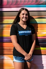 Harper Creek graduating senior Alysa Wager stands for a picture on Thursday, June 11, 2020 in downtown Battle Creek, Mich. Wager became a two-time state champion in swimming in the same season and signed swim for Grand Valley State University.
