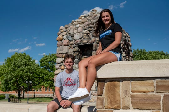 Battle Creek Enquirer's 2020 Athletes of the Year Conor Gausselin from St. Philip and Alysa Wager from Harper Creek take pictures together on Thursday, June 11, 2020 in downtown Battle Creek, Mich.