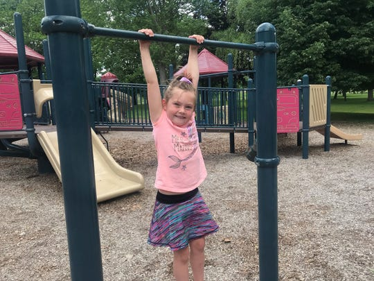 Paislee Gregory, 6, of Port Crane, played on the monkey bars of Otsiningo Park in the Town of Dickinson on June 12, 2020.