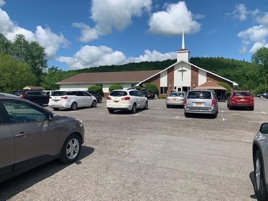 Cars full of worshippers listen to a drive-in service at the Endicott Community Church of the Nazarene. The church holds drive-in services every Sunday.
