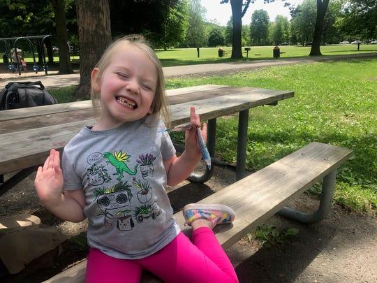 ReAnn Keller, 4, of Newark Valley, ate a picnic lunch at Otsiningo Park on June 12, 2020.
