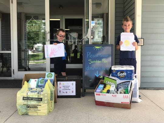 Bucyrus residents and Wynford students Waylon Bennett, 7, left, and Declan Bennett, 9, have a passion for fundraising and helping local causes. Along with grandmother Mary Clark, the boys donated needed items for the Crawford County Council on Aging's Sunshine Bags project, benefitting home bound seniors and those who receive COA services.