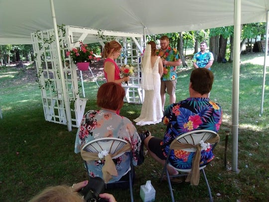 Elizabeth and Cody Parah exchange vows at their wedding June 6, 2020.