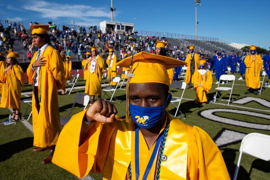 Moody graduate Amarion Marcellas Johnson kneels during the National Anthem at Moody High School's 2020 commencement ceremony at Cabaniss Stadium on Thursday, June 11, 2020.