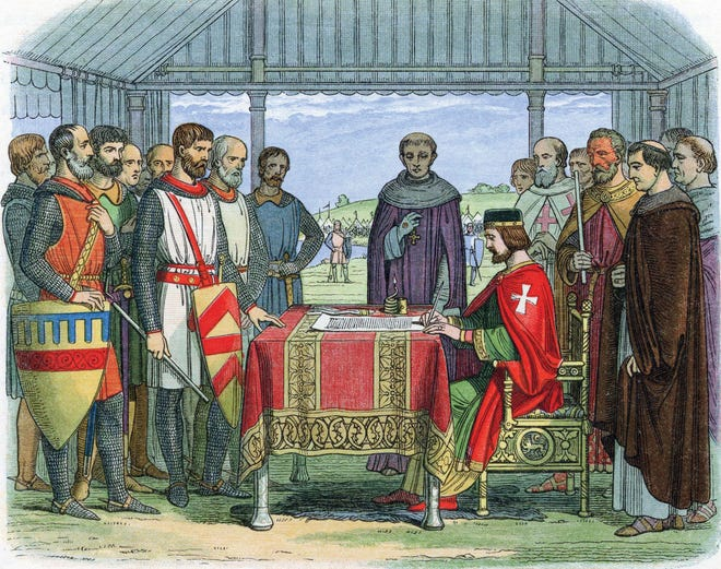 An engraving of King John signing the Magna Carta on June 15, 1215, at Runnymede, England.