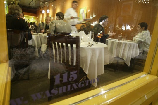 This is a look into the front window of Ann Arbor restaurant , Logan, at 115 W. Washington in downtown Ann Arbor Tuesday, Jan. 25, 2005, just two months after it opened. Logan announced it would be permanently closing during the COVID-19 crisis of 2020.