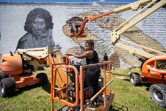 Artist Sydney G. James works on a 3,500-square-foot unfinished mural of Malice Green on Hamilton Avenue in Highland Park on Thursday, June 11, 2020. James put up a GoFundMe campaign to raise $10,000 to work on the mural and met the goal within two and a half hours.