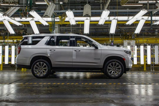 The 2021 Chevrolet Tahoe rolls off the line at GM's Arlington Assembly plant.