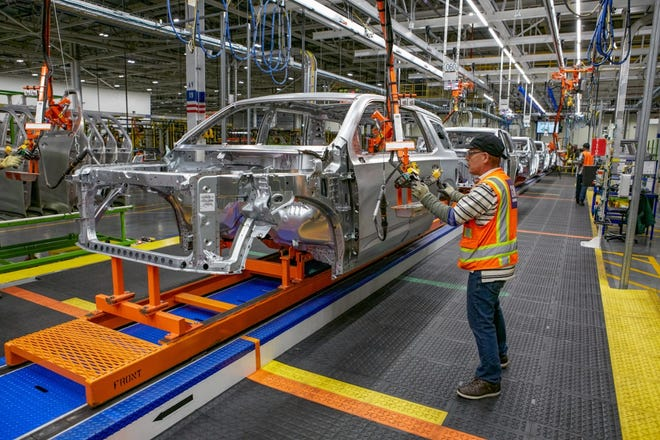 Body assembly of the 2021 Chevrolet Tahoe within the new, 1-million-square-foot body shop at GM's Arlington Assembly plant.