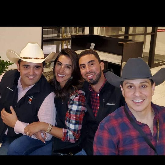 Armando Herrera and his fiancee, Erika Licon, far left, installed a security vault in their Toyota Tundra. Herrera and Licon attend the Houston Livestock Show and Rodeo Bar-B-Que Cook-Off competition on March 2 with Larry Grajales and O.J. Lozano.