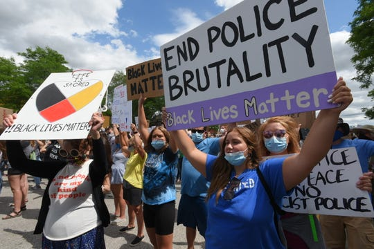 Supporters march for racial justice and an end to police brutality on Main Street in downtown Romeo, Friday afternoon, June 12, 2020, before arriving at Romeo Park for a vigil with speakers from the community. The event is also in response to an incident earlier this week in which The Romeo Rock was defaced with racist remarks.