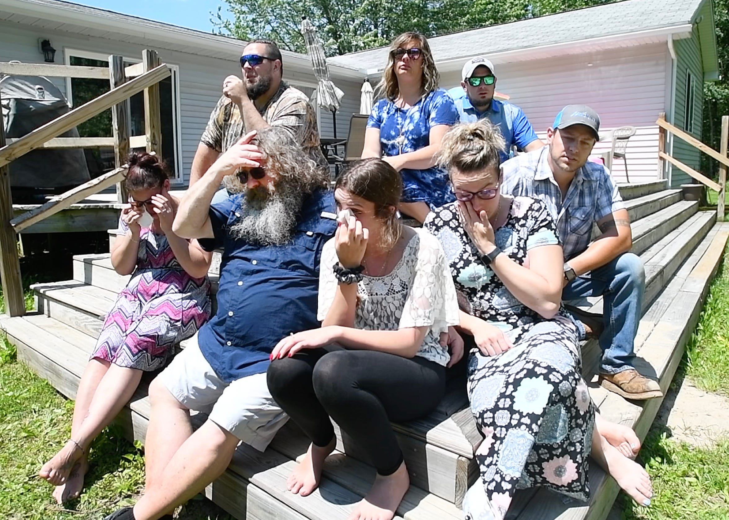 The family, daughter-in-law Savanah Eagan, son Jonathan Eagan, husband Kevin Hennig, daughter Jessica Riggs, daughter-in-law Nicole Eagan, daughter-in-law Brooke Eagan, son Joshua Eagan and son Jereme Eagan, of respiratory therapist Carrie Lynn Hennig, who died of COVID-19 speak of their mother and wife at her son's home in Beaverton on June 11, 2020.
