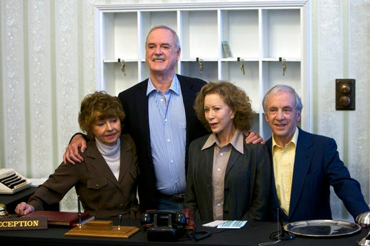 """In this file photo dated Wednesday, May 6, 2009, the cast of Fawlty Towers from left, Prunella Scales, John Cleese, Connie Booth and Andrew Sachs reunite to celebrate the 30th anniversary of the TV show and mark a special programe """"Fawlty Towers: Re-opened"""" at The Naval and Military Club, London.  One of the most memorable episodes of one of the most popular British sitcoms of all-time, Fawlty Towers, has been withdrawn from a streaming service because of numerous racial slurs."""