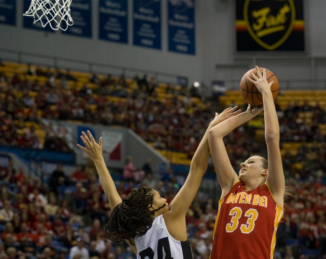Mater Dei's Tori Schickel (33) shoots over Western's Siera Daniel at the Hulman Center in Terre Haute, Ind during the state championship game. Schickel finished with nearly 2,000 career points and over 1,000 rebounds at Mater Dei.