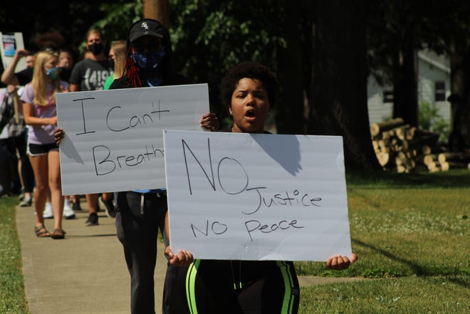 Shakayla Braggs marches in Clyde for racial equality Thursday, as she and about 25 other protesters gathered for a peaceful protest.