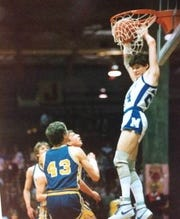 In this photo circa 1985, Malta's Mike McNamara (24) flushes one through the hoop.