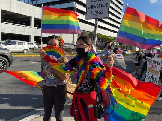 Demonstrators representing the LGBTQ community and supporters gather at the ITC intersection Friday, June 12, 2020, to show solidarity with the Black Lives Matter movement