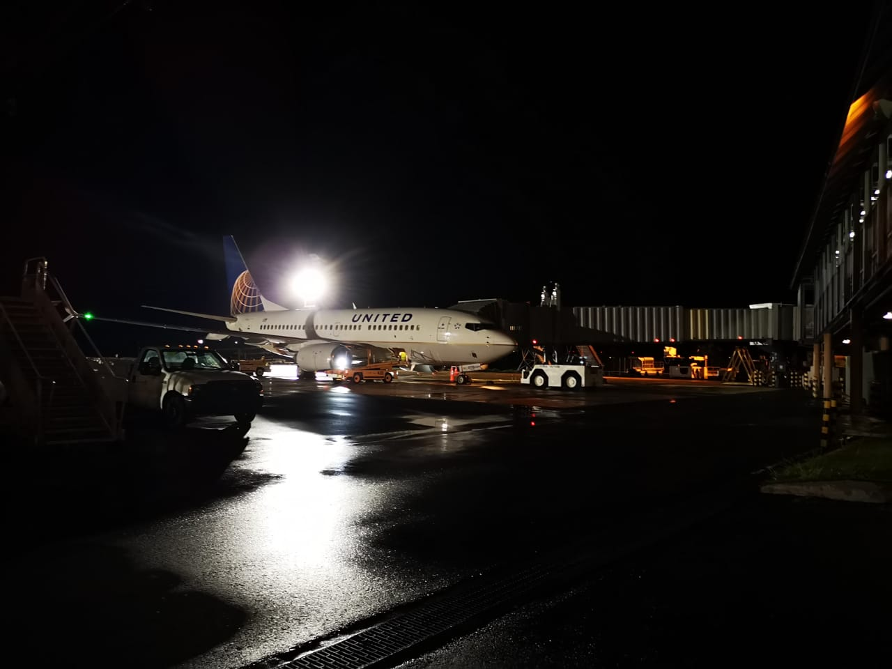 In this file photo, a United Airlines flight arrives at the Palau International Airport bringing 47 passengers from Guam. The Palau Ministry of Health announcedtwo Palau residents in quarantine on Guam tested positive for COVID-19.