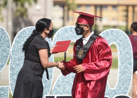 "JP Torres Success Academy graduates receive diplomas during their ""Grad & Go"" ceremony at Tiyan High School, June 12, 2020."