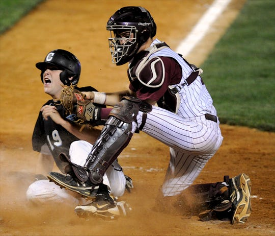 Collins' David Decker objects to the call as Henderson County catcher Andrew Richmond tags him out at home on a throw from shortstop Ethan Meeler to keep the Titans from scoring during the 2013 state tournament game in Lexington.