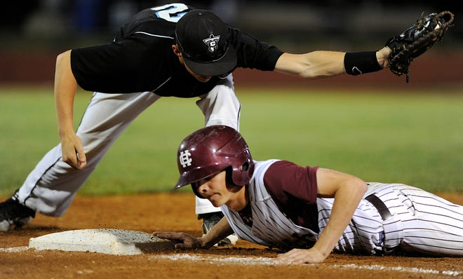 Henderson County's Colin Hudson, right, jumps safely back to first as Collins' Paul Miller tries to lay down the tag during the 2013 state baseball game in Lexington.
