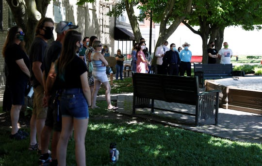 People gathered in Lancaster's downtown in solidarity for people of color who experience systemic racism in the legal system at a demonstration Friday, June 12. The event was organized by Dorian Baum, a local attorney.