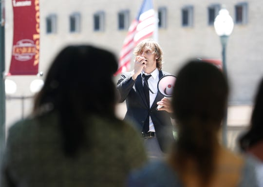 Dorian Baum speaks through a megaphone to address the people gathered in downtown Lancaster during a solidarity demonstration addressing the inequality of the legal system for people of color Friday, June 12.