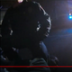 A screenshot from body camera footage shows East Lansing Officer Andrew Stephenson kneeling on the neck of a handcuffed man.
