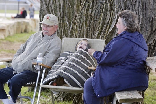 Grandparents with their grandson await the arrival of the S.S. Badger Lake Michigan car ferry in Manitowoc Friday, June 12, 2020.