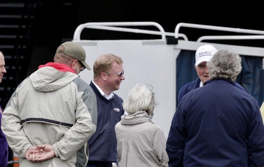 Manitowoc Mayor Justin Nickels (blue jacket and sunglasses) greets passengers from the S.S. Badger after the Lake Michigan car ferry arrives in Manitowoc after its first voyage of the season.