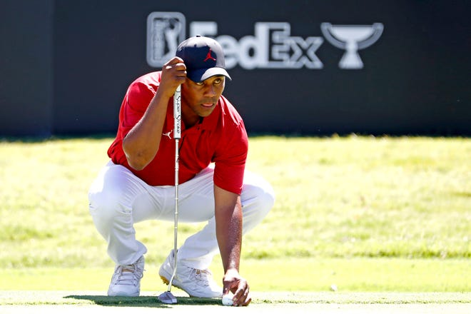 Harold Varner III lines up his putt on the 14th green during the first round of the Charles Schwab Challenge golf tournament Thursday.