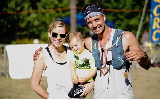 Bilan and Chad Hockers, of Muskego pose with their son, Landon on Aug. 16, 2019 after Chad finished the Marquette Trail 50 Ultramarathon Race in honor of the couple's twins, Liam and Noah, who were stillborn and to raise money for ICP.
