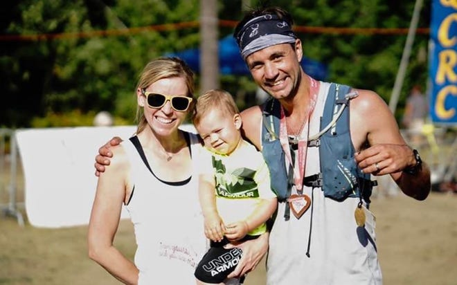 Bilan and Chad Hockers, of Muskego with their son, Landon in August 16,2019 after Chad finished the Marquette Trail 50 UltramarathonRace In honor of the couple's twins, Liam and Noah, and to raise money for ICP.
