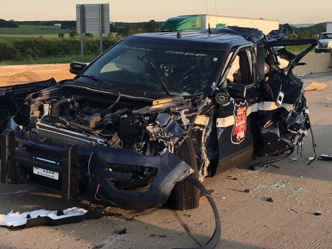 A Wisconsin State Patrol squad car is totaled in a crash in Columbia County and two others that resulted in four fatalities and multiple injuries Friday morning.