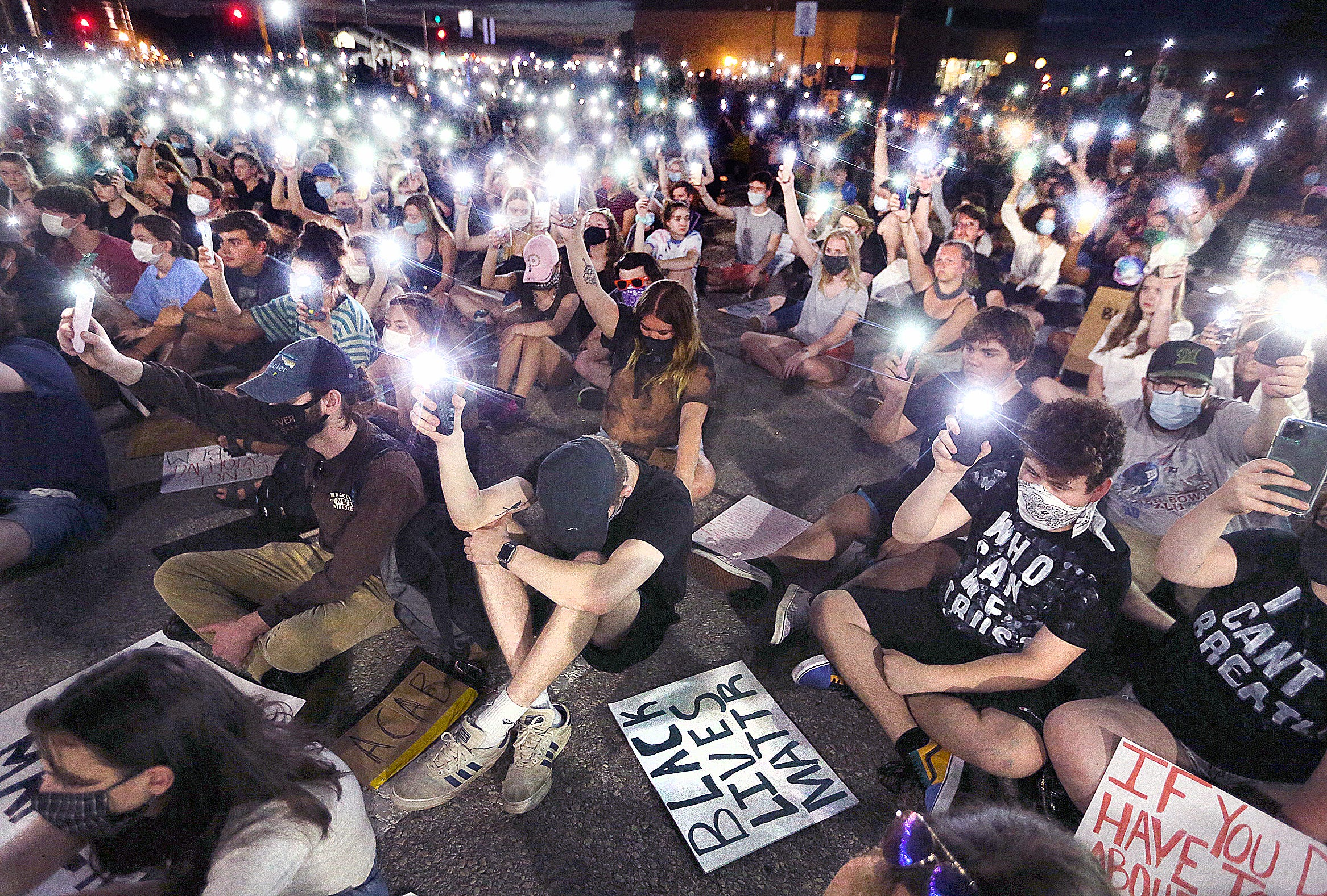Demonstrators raise the flashlights on their cell phones City Hall during a nine-minute period of silence to honor George Floyd who, according to an autopsy, died of asphyxiation after being restrained by a Minneapolis Police officer for nine minutes. A crowd of about 700 people, estimated by the La Crosse Police Department, was present for the Justice for George Floyd rally that began in Riverside Park.