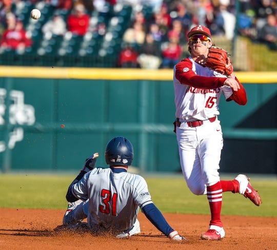 Arkansas junior shortstop Casey Martin (15) of Lonoke attempts to turn a double play against Gonzaga earlier this season at Baum-Walker Stadium in Fayetteville.