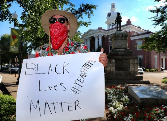A Black Lives Matters protester Michael Sangetti stands on the street corner in front of the Confederate statue on the Court Square in Murfreesboro,  Thursday, June 11, 2020.