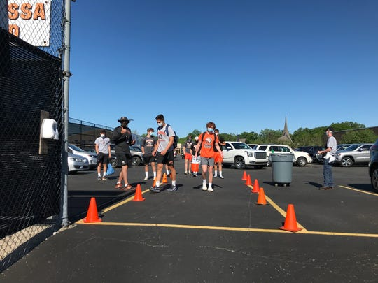 Brother Rice football players had to have their temperature taken and sent to the coaching staff at most one hour before arriving to practice.